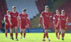 The Aberdeen players troop off after their Scottish Cup loss to Dundee United