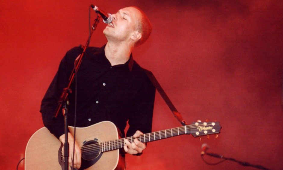 Coldplay frontman Chris Martin performing live in 2001, the year the band played the Music Hall in Aberdeen.