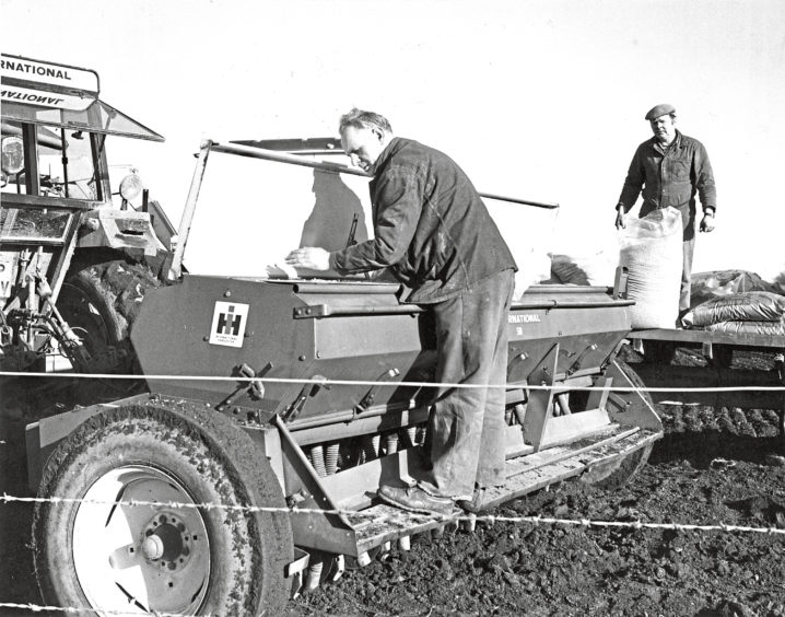 1981 - Bob Stewart and Alistair West prepare to sow a 27-acre field with barley at Mains of Kair, Fordoun