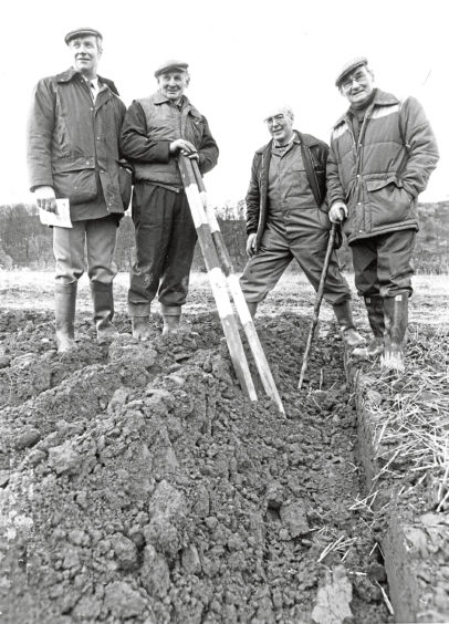 1988 - Keeping a trained eye on a ploughing contest are James Ross, Ernest McIntosh, William Watt and William Daniel