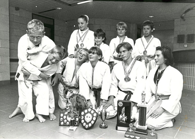 1992 - Aberdeen Judo Club members show off the 20 medals and trophies they won at the Open tournament