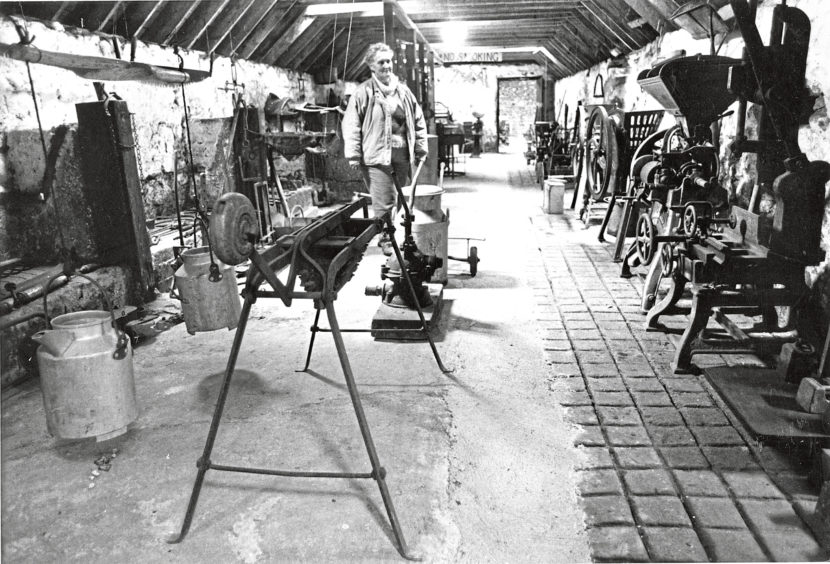 1989 - Tom Hamilton's museum of farm machinery near New Pitsligo, with his wife Jill in the home equipment section
