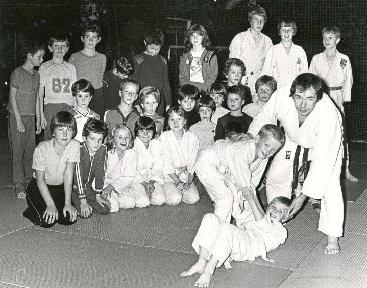 1982 - Instructor Andy McLean demonstrates a throwing technique using two pupils at the Beacon Centre