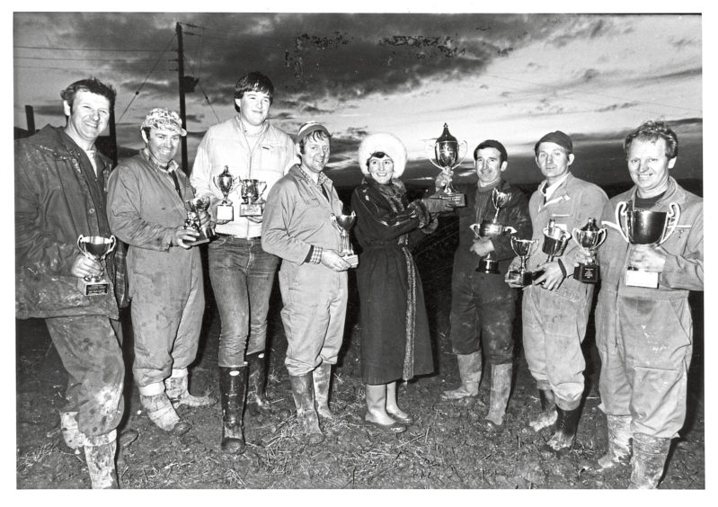 1985 - Winners at a ploughing match at Overton of Straloch, Newmachar, line up to collect their silverware