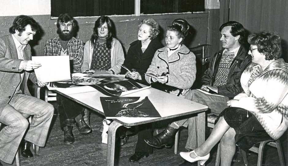 1979 - Grampian Health education officer Malcolm McNeil, left, advises residents on how to kick smoking