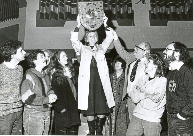 1986 - Ferryhill Players producer Betty Doig shows off the Rowntree Harvey Shield after it was presented to her by theatre critic Alistair Selway, third right
