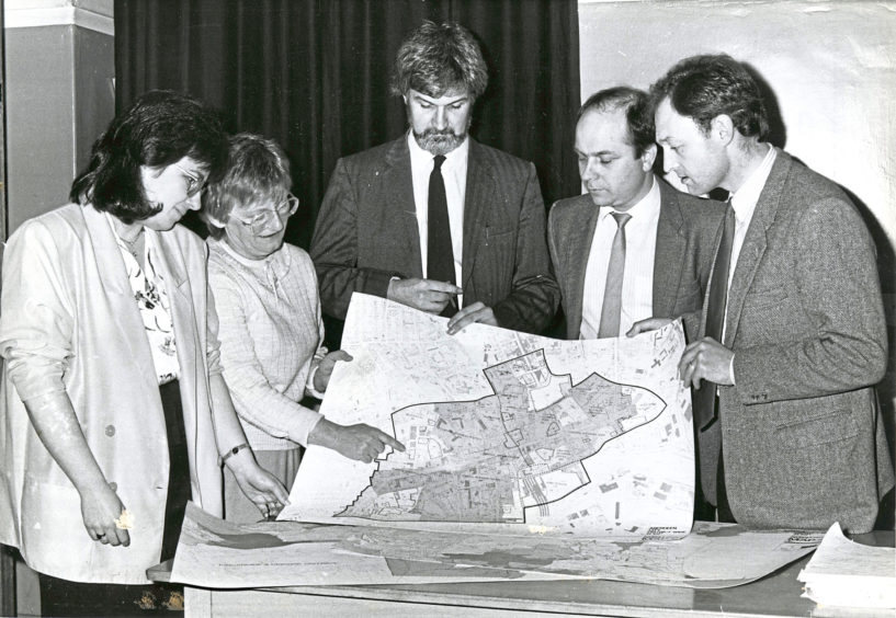 1988 - Looking at plans are, from left, Anne Ludbrook, Maureen Keay, Malcolm Campbell, Jim Crawford and Jack Winchester