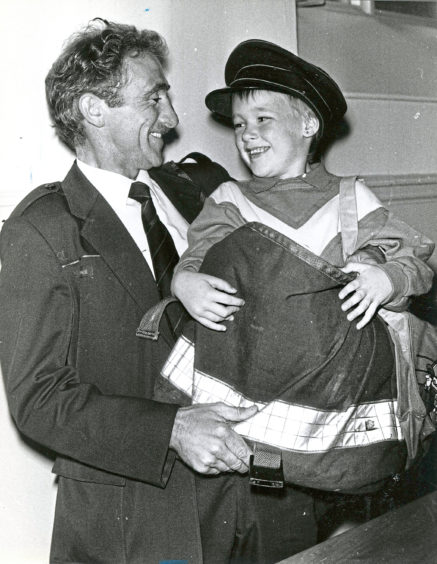 1988 - Postman Andy Arnott delivers Nicholas Reynolds, 6, to South Church summer camp