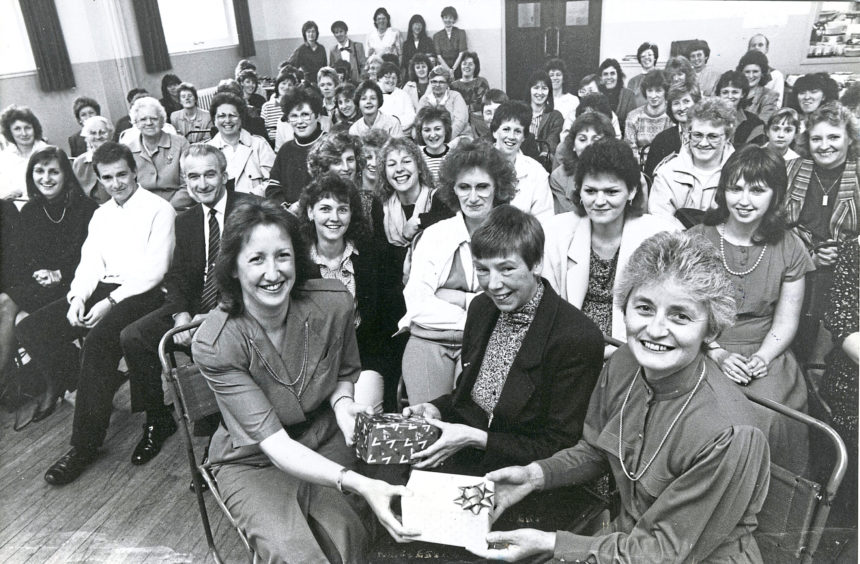 1989 - Mrs Penny Letts, of the Ferryhill South Church playgroup, presents retirement gifts of cameras to Mrs Wilma Cumming, right, and Mrs Meg Young, centre