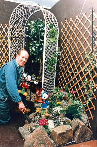 1992: Findlay Clark shop manager Frank Gray has a wide selection of ideas for conservatory, patio or garden.