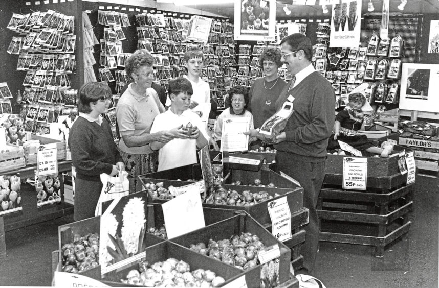 1993: Findlay Clark garden centre manager Henry Brown shows customers a selection of bulbs.