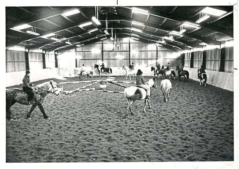 1969: The new indoor riding school of the Hayfield Centre at Hazlehead, Aberdeen, which the public are invited to visit next Saturday. Below is Miss Morven Will on Manolito who can unbolt his loosebox door.