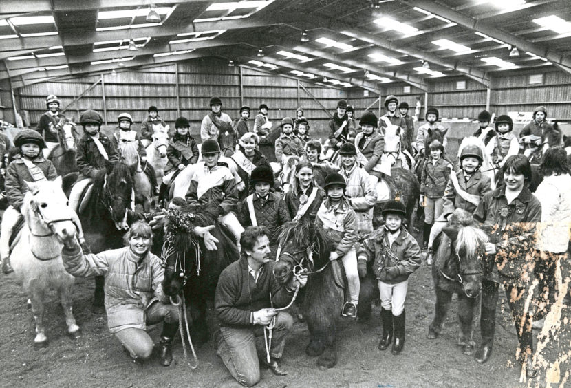 1986: Young riders and their mounts enjoying the Pony Club party at Hayfield Riding School, Aberdeen.