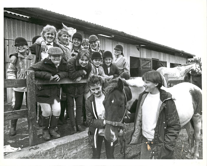 1986: Studying their mounts are these youngsters who took part in the hunter trial competition at Hayfield Riding School, Aberdeen, on Saturday.