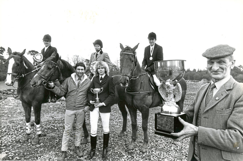 1987: Hayfield Riding Centre held their trophy show over the weekend, and showing off their silverware are winners (left to right) Joe Ronald, Aberdeen, with the Drummond Shield; Mr John Crawford, centre owner; Toots Waters, Watten, Caithness, with the Selbie Shield; Lynne Prentice, Aberdeen, with the George Mair Trophy; Mr Andrew Haig, Newtonhill, with the small medallion and winner of the Stephen Hadley Trophy, which is held by winter series judge Mr Bill Strachan.