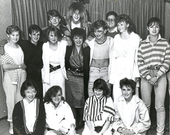 1987: Night out time for 17 year old Lucia McOmish (middle, third left) and 18 year old Frances Moore (fourth left) pictured with students and friends at a party in the Palm Court Hotel, Aberdeen, to mark their leaving after two years YTS as riding instructors at the city's Hayfield Riding School.