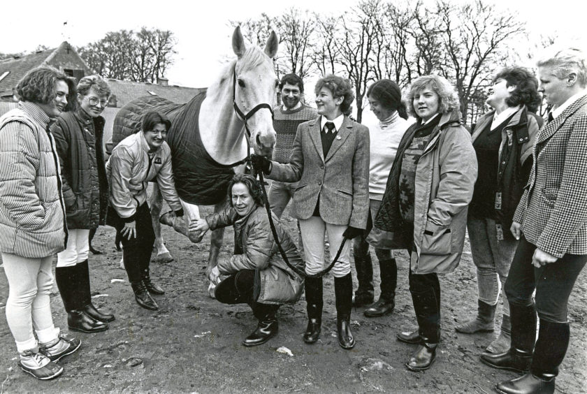 1989: Checking this horse's leg during a visit to Hayfield Riding School, near Aberdeen, by members of the Huntly YTS (Equestrian) venture are training co-ordinator Mrs Ailsa McIntosh (third left) and scheme manager Mrs Jane Pidcock. The scheme has 35 participants who gain experience in a variety of stables in the North-east for work in the horse related industry