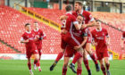 Aberdeen celebrate Lewis Ferguson scoring the opener.