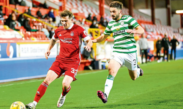 Aberdeen's Matty Kennedy, left, and Greg Taylor of Celtic in action.