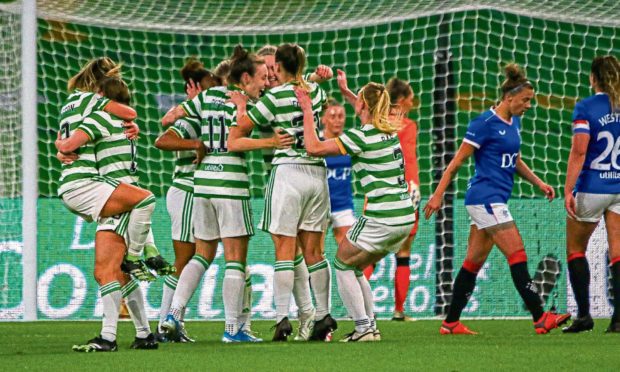Mariah Lee celebrates her goal against Rangers with her Celtic team-mates.