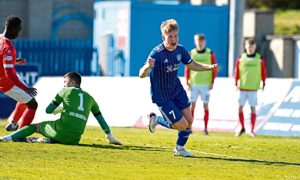 Peterhead's Hamish Ritchie makes it 2-0 to the Blue Toon against Clyde.
