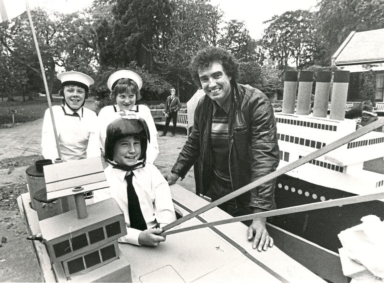 1982: Pupils at an Aberdeen school have been showing the makers of a national children's TV programme how they can have fun and raise money for charity in the process. More than 80 pupils from Hazlehead Academy turned up in Hazlehead Park with eight boats on wheels. Dressed in appropriate garb the children then pushed disguised supermarket trolleys in a race round a circuit.