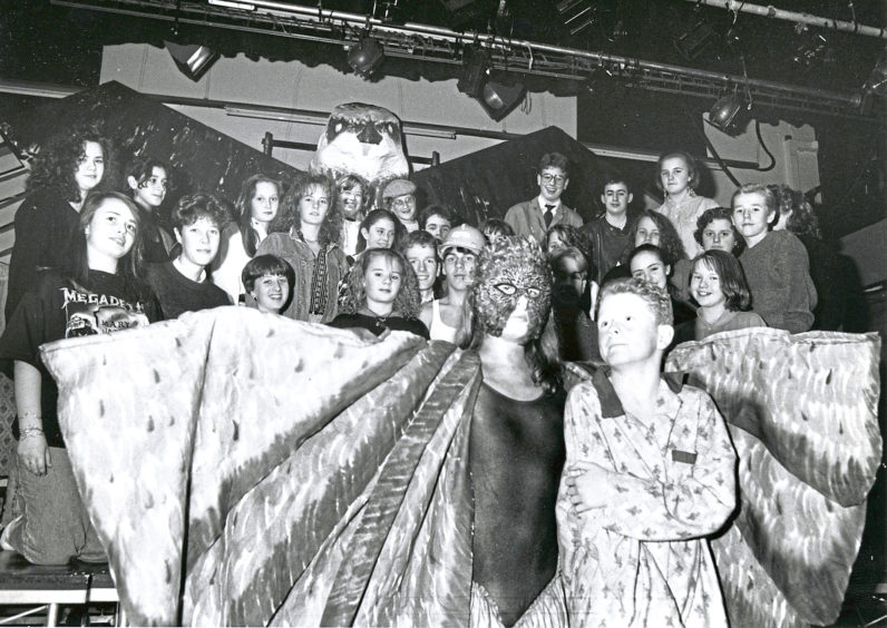 1990: Hazlehead Academy's Channel 5 Theatre Company begin a three night run of Kes tonight in the school's assembly theatre. Billy, played by Steven Milne (front right), rescues and makes friends with a kestrel, played by Marianne Thorburn. The rest of the cast surround them.