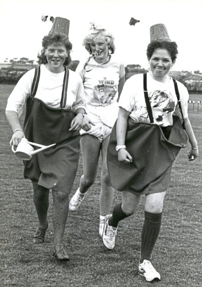 1987: Hazlehead Academy pupils Louise Mutch (left), Caireen Dalarno and Paula Angus lapped up a fancy dress fun run at the Aberdeen school. They were among 265 pupils who pounded the sports field in the sponsored event to raise money for charity. The trio, suitably dressed up for the occasion, ran 1km - two and a half laps of their sports fields.