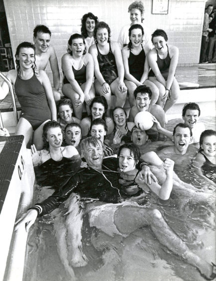 1989:  No escape for referee Alister Sinclair, in these pictures by Roy Donaldson, as Lydia Philippo (left) and Jane Anderson push him into the pool at Hazlehead Academy, Aberdeen, after the annual Lympics water polo match between the staff and pupils. The match, which was won 8-6 by the staff, gave them a 3-0 lead in the six event Lympics.