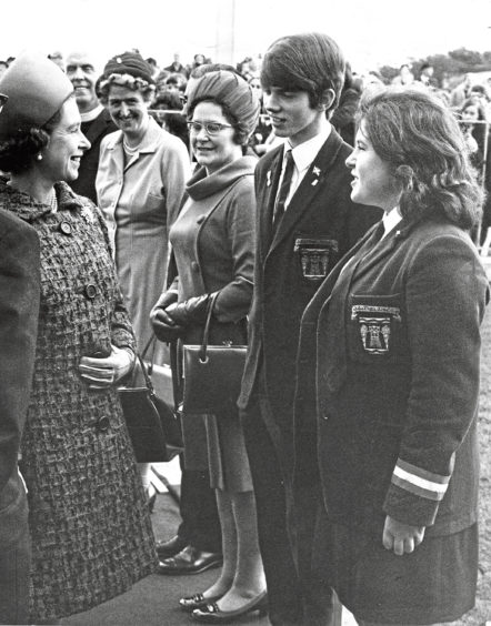 1970: The Queen speaks to senior prefects Derek Archibald and Edna Christie at Hazlehead Academy today at the schools official opening.