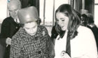 1970: The Queen attended Hazlehead Academy for its official opening. Third year pupil Linda Williamson explains techniques of design to the Queen in the art department.