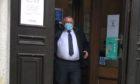Andrew Thomson leaving court.