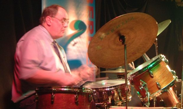 Jazz hero Bill Kemp in his element on the drums.