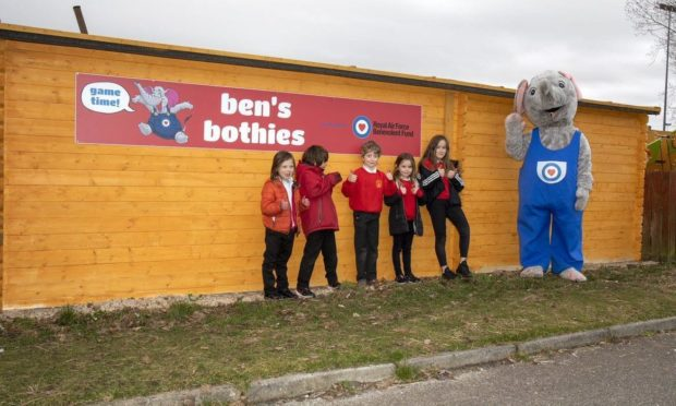 Youngsters with mascot outside one of the outdoor classroom at RAF Lossiemouth.
