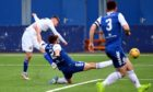 Connor Smith shoots for goal during Cove Rangers' game with Montrose.