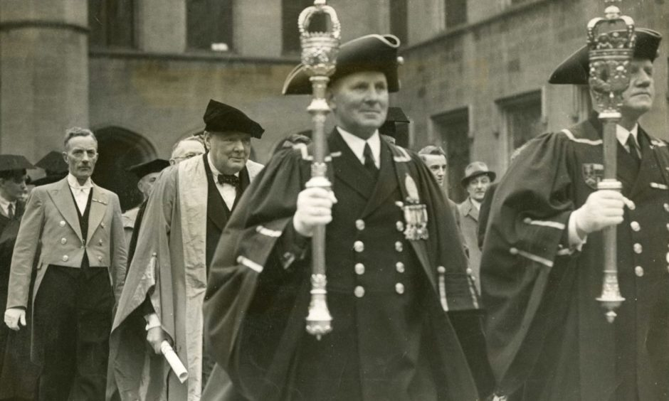 Sir Winston Churchill in the procession when he received the honorary degree of LL.D (Doctor of Laws of the University), at Aberdeen University in 1946.