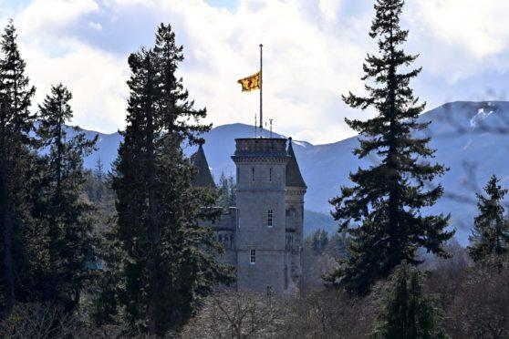 Balmoral Castle flying the Flag at half mast