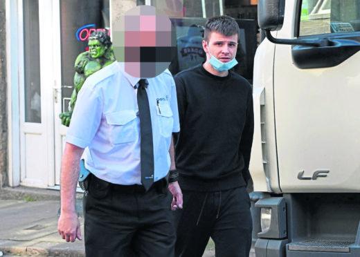 Craig Murray leaving court.