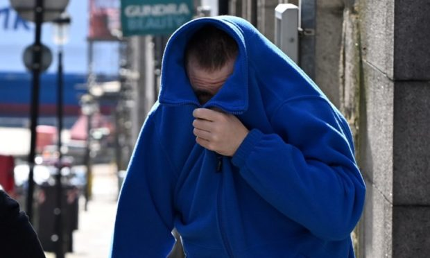 Robert Garden tried to hide his face as he left court.