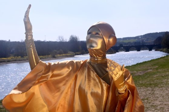 Maja in her gold outfit at the River Dee.