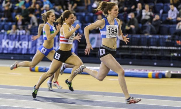 Kathryn Christie beating World Championship medallist Zoey Clark to the Scottish 60m title in 2014.