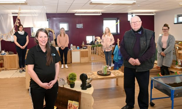 Community manager Connie Strachan and Cllr Norman Smith at the new extension in the new nursery in Mintlaw.  back row are nursary staff Gillian Merchant, Sarah Adams, Angie Urquhart and Ashton McCouaig.