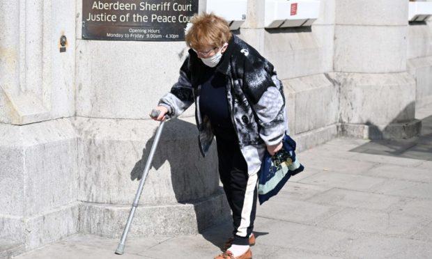 Agnes Gibb or Clark outside court.