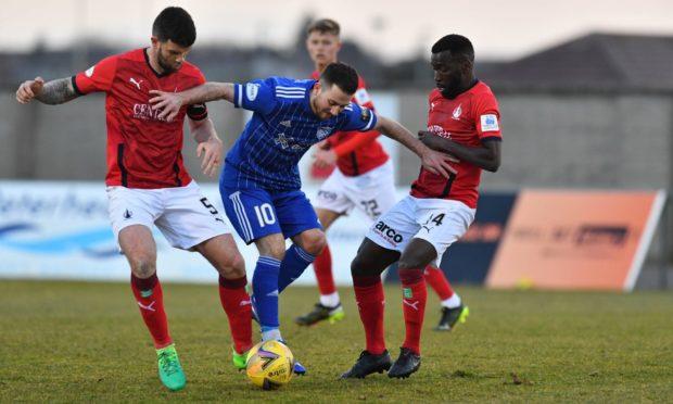 Steven Boyd, centre, battles for possession