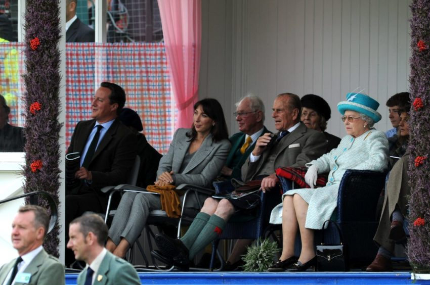 Braemar Royal Highland Gathering 2011.  Prime Minister David Cameron and wife  Samantha, Prince Philip and the Queen during the games. Picture by Kenny Elrick.