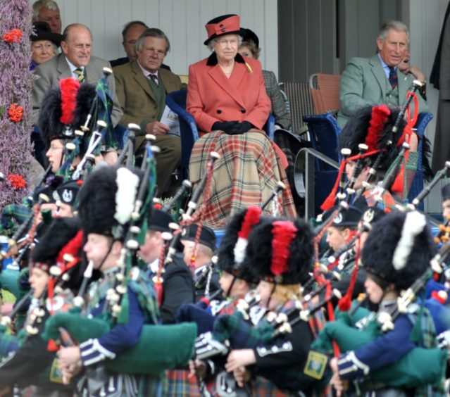 Braemar Royal Highland Gathering 2008.    Pictured - The Queen with Prince Philip and Prince Charles watch the events at the games.   -  Picture by Kami Thomson