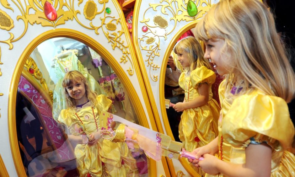 Abigayle Morrison looks at the fairy mirror in the new Disney Store in the Bon Accord Centre.   Picture by KEVIN EMSLIE