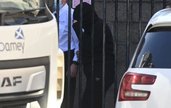 Megan Robertson hid her face as she left court.