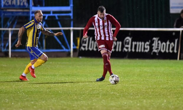 Craig McKeown, right, in action for Formartine.