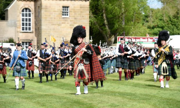 Pipers perform at the Gordon Castle Highland Games in 2018.